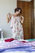 Woman trying on a dress at home Stock Photos