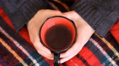 Warm female hands holding a cup of  Tea for the cold  winter days Stock Footage