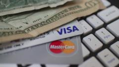 ECOMMERCE - Macro Dolly to Reveal Credit cards and cash on keyboard Stock Footage