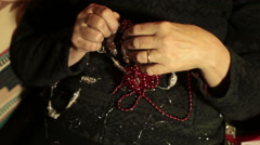 Untangling christmas beads Stock Footage