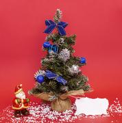 christmas composition with santa claus and adorned tree - stock photo