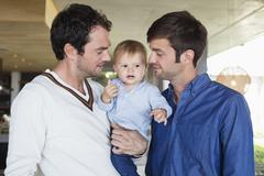 Parents with their son at home Stock Photos