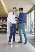 Parents smiling with their son at home Stock Photos