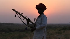 Indian musician at the attended the annual Pushkar Camel Mela, Rajasthan, India Stock Footage