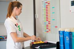 Female nurse arranging schedule in hospital Stock Photos