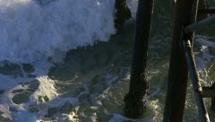 Pier Pylons Are Hit By Splashing Wave Slow Motion Stock Footage