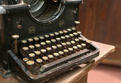 Ancient rusty typewriter used by typists than once Stock Photos
