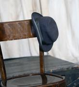 Hat of an elder leaning on wooden chair Stock Photos