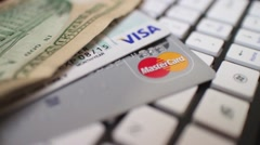 ECOMMERCE Macro Dolly - Credit cards and cash on keyboard Stock Footage