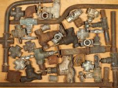 Old and rusty fittings and valves. Stock Photos
