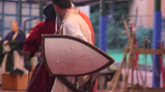 Warriors in historical re-enactment of medieval battle - stock footage