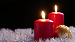 Red Candles with Gold Bauble - stock footage