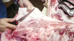 Old butcher cutting big chunk of meat in slow motion Stock Footage