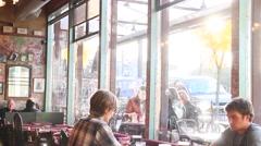 2 caucasion men - enjoying beer in restaurant - dolly shot Stock Footage