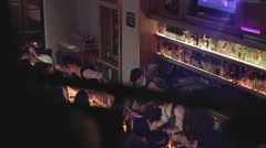 Birds eye - dolly shot of bar area and people enjoying lounge Stock Footage