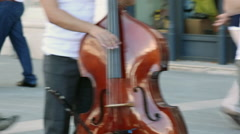 Street musician plays double bass Stock Footage