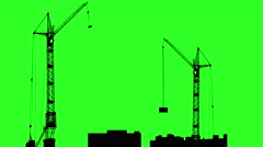 silhouette of two cranes working on the building. green screen background. 4k - stock footage