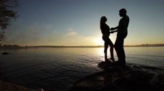 Stock Video Footage of Silhouette of couples at sunset