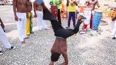 A group of people playing Capoeira Stock Footage