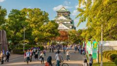 4k timelapse video of people visiting Osaka Castle in Osaka, Japan Stock Footage