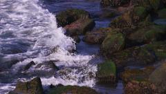 Ocean Waves Splash on Mossy Rocks In La Jolla California Stock Footage