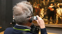 Man taking photo of Night Watch by Rembrandt Stock Footage