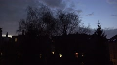 4k The night comes with backstreet clouds windows and tree Stock Footage