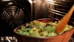 Baked potatoes with mushrooms in pottery Stock Footage