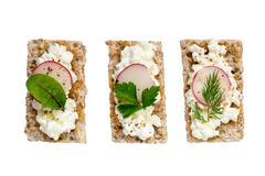 crispbread variation with cottage cheese radishes and herbs - stock photo