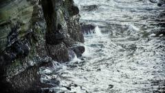 Lower Ocean Cliff Pounded by Waves, California USA Stock Footage