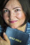 Adult woman reading a bible Stock Photos