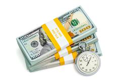 Time is money concept - stopwatch and stack of dollars - stock photo