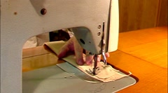 Man working on old-style manual sewing machine. With sound -time lapse - stock footage