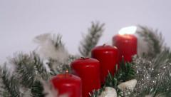Blow out the candles on christmas decoration with candle for advent season Stock Footage