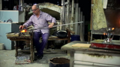 Glassmaker in action, Murano furnace Stock Footage