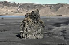 Volcanic rock pillar in the beach of Dyrhólaey in the southern coast of Iceland  - stock photo