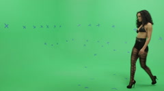 Beautiful Woman on Green Screen Walking for the Camera Stock Footage