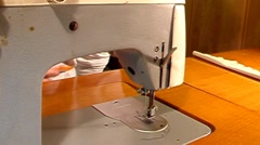 Man working on old-style manual sewing machine. With sound - stock footage
