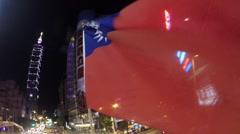 Stock Video Footage of Taiwan Beautiful Cityscape, Taipei 101 Skyscraper night Flag wind at traffic-Dan