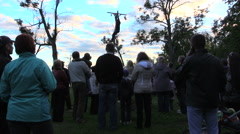 Stock Video Footage of People look at man successfully climb on high log pole get prize