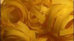 Rolled pasta Fettuccine  rotating in front of camera Stock Footage