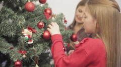 Girl assembling the christmas tree - stock footage