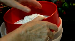 Mature woman sifts the flour through a sieve Stock Footage