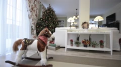 Christmas morning with Christmas tree and toy horse Stock Footage