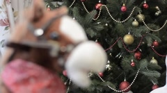 Horse toy and Christmas tree Stock Footage