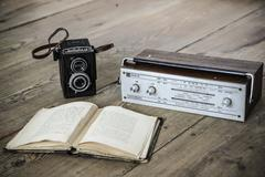 Vintage camera and radio and book Stock Photos