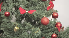 Boy and his mom smiling beside the christmas tree Stock Footage