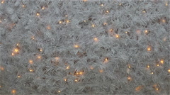 Large white garland decorated with festive Christmas tree on New Year's Eve Stock Footage
