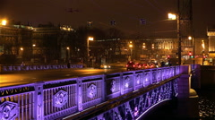 the rhythm of life on the Palace bridge at night in the city center - stock footage