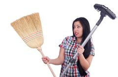 Young housewife doing housekeeping on white Stock Photos